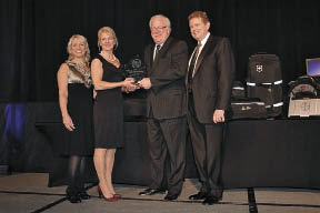 Black Gold CEO Gregg Halverson receiving Top Producer Award