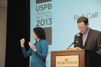 2012-2013 USPB Chair Sid Staunton goes through roll call while an interpreter signs the names for a deaf reporter