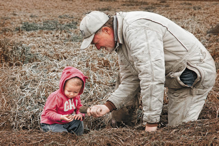 Gavin Johnson teaches his granddaughter Kamryn