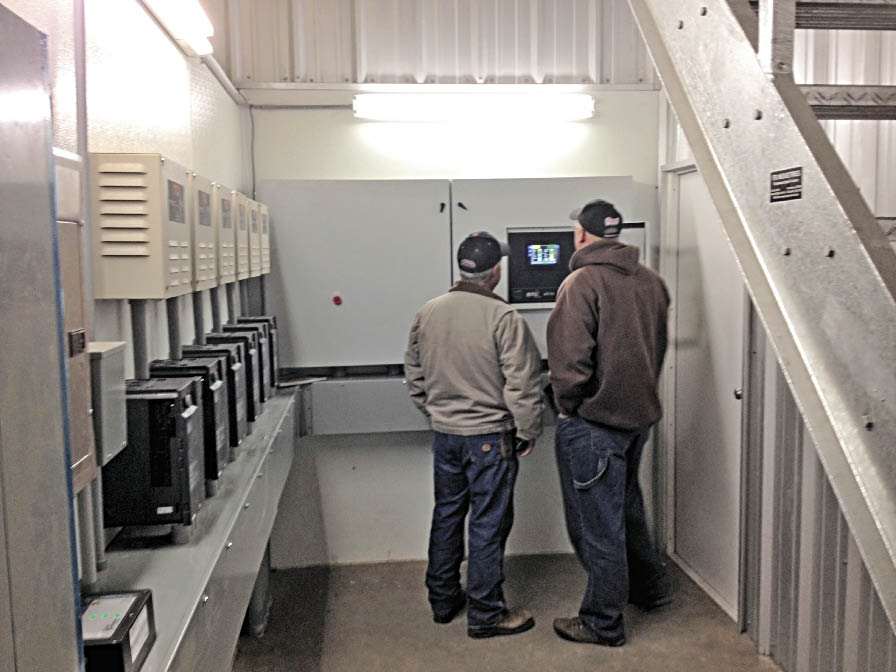 Al Simmons instructs Lionel Lopez how to operate new BTU XT-70 control system.